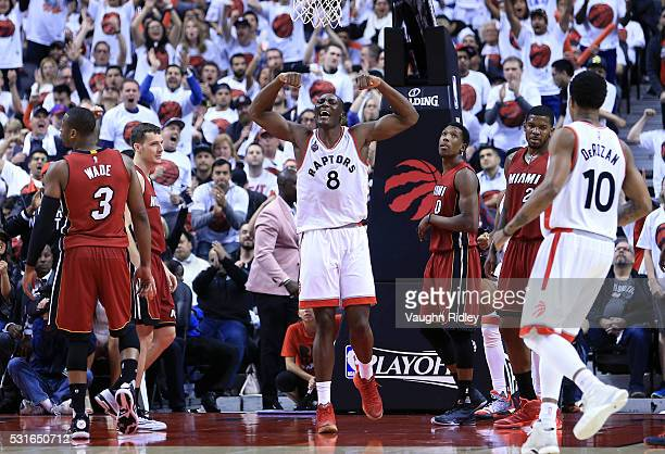 Bismack Biyombo of the Toronto Raptors celebrates a basket in the second half of Game Seven of the Eastern Conference Quarterfinals against the Miami...