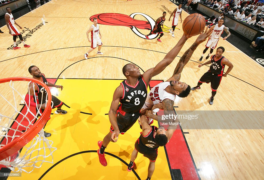 Bismack Biyombo #8 of the Toronto Raptors defends against Udonis Haslem #40 of the Miami Heat in Game Four of the Eastern Conference Semifinals during the 2016 NBA Playoffs on May 9, 2016 at American Airlines Arena in Miami, Florida.