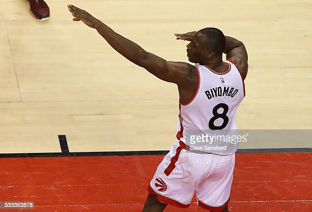 Bismack Biyombo of the Toronto Raptors gestures to the crowd after dunking the ball against the Cleveland Cavaliers in Game Three of the Eastern...