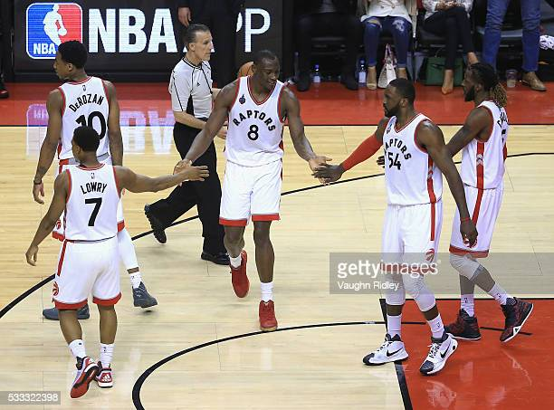 Bismack Biyombo of the Toronto Raptors high fives teammates during the second half against the Cleveland Cavaliers in game three of the Eastern...