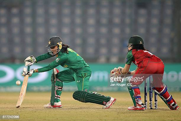Bismah Maroof of Pakistan steers the ball with Nigar Sultana of Bangladesh looking on during the Women's ICC World Twenty20 India 2016 match between...