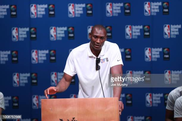 Bismarck Biyombo of the Charlotte Hornets speaks during the Opening Ceremony at the Basketball Without Boarders Africa program at the American...