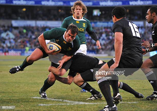 Bismarck du Plessis of South Africa drives to the tryline during the 2009 Tri-Nations Series match between South Africa and New Zealand at Vodacom...