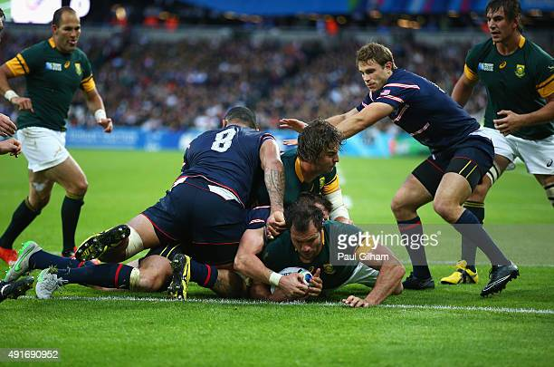Bismarck Du Plessis of South Africa goes over to score their fourth try during the 2015 Rugby World Cup Pool B match between South Africa and USA at...