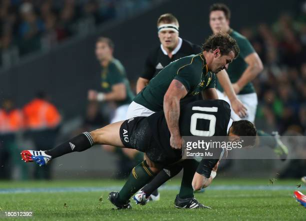 Bismarck Du Plessis of South Africa hits Dan Carter of the All Blacks during The Rugby Championship match between the New Zealand All Blacks and the...