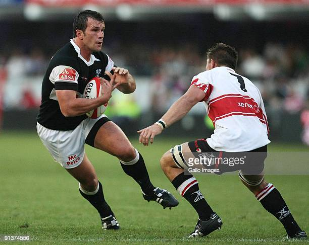 Bismarck du Plessis of the Sharks is challenged by Derek Minnie of the Lions during the Absa Currie Cup match between the Sharks and Lions from Absa...