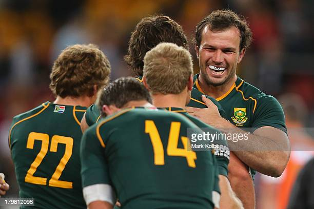 Bismarck du Plessis of the Springboks celebrates victory with his team mates during The Rugby Championship match between the Australian Wallabies and...