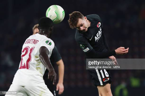 Bismark Adjei-Boateng of CFR Cluj and Håkon Evjen of AZ Alkmaar fights for the ball during the UEFA Europa Conference League group D match between...