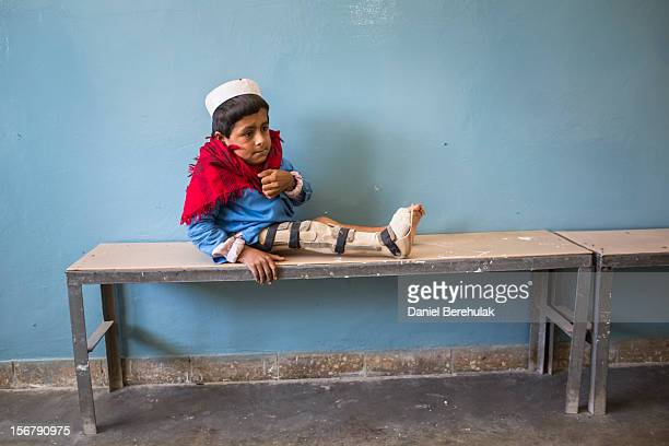 Bismillah Gul suffering from poliomyelitis waits for his father Masta Gul after having travelled from Khost province to get treatment at the...