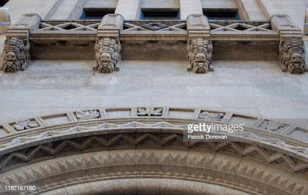 bison head details on federal building, winnipeg, manitoba - art deco stock pictures, royalty-free photos & images