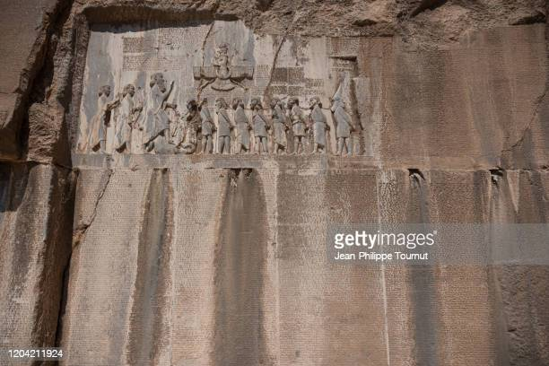 bisotun / behistun inscription and the message from darius the great engraved in cliff of zagros mountains, kermanshah province, iran - foot bone stock pictures, royalty-free photos & images