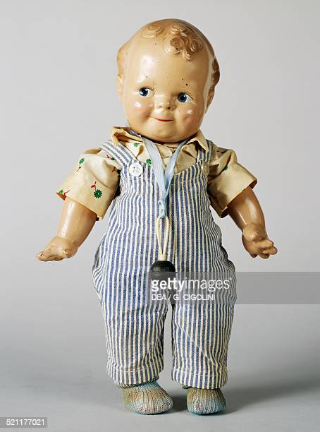 Bisque Scootles/Kewpie doll with striped dungarees made by Kewpie 1925 United States of America 20th century United States