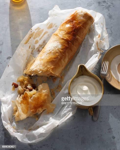 Bistro dessert of apple strudel and cream on table