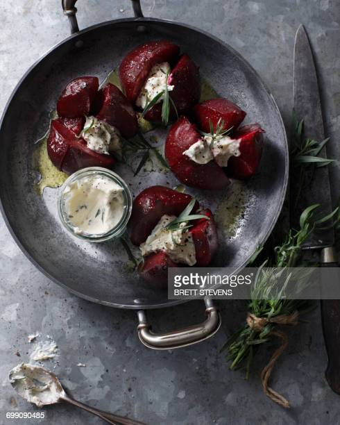 Bistro table with dish of whole beetroots, horseradish and tarragon