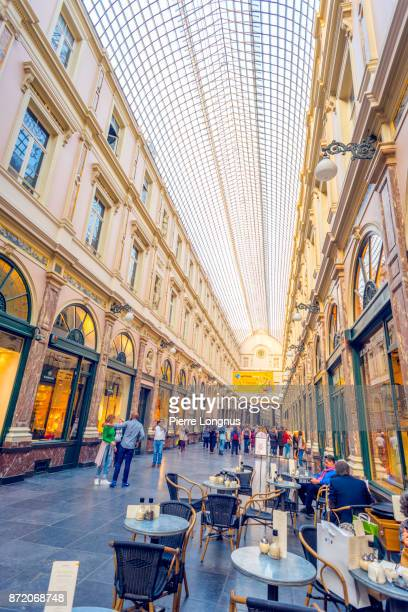 Bistrot-Café where tourists are having a cake and tea or coffee while others are strolling under the glass-roofed of Galeries Royales Saint-Hubert, one of several Arcade galleries in Brussels, Belgium