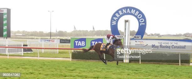 Bit of a Lad ridden by John Allen wins the Greg Bull Painting 1JW Hurdle at Warrnambool Racecourse on July 08 2018 in Warrnambool Australia