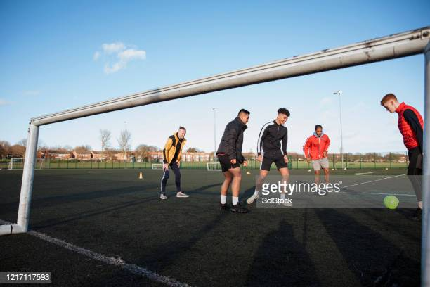 bit of striker practice - football stock pictures, royalty-free photos & images