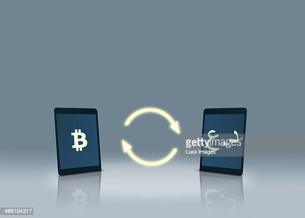 Bitcoin and Iraqi dinar symbols on tablets