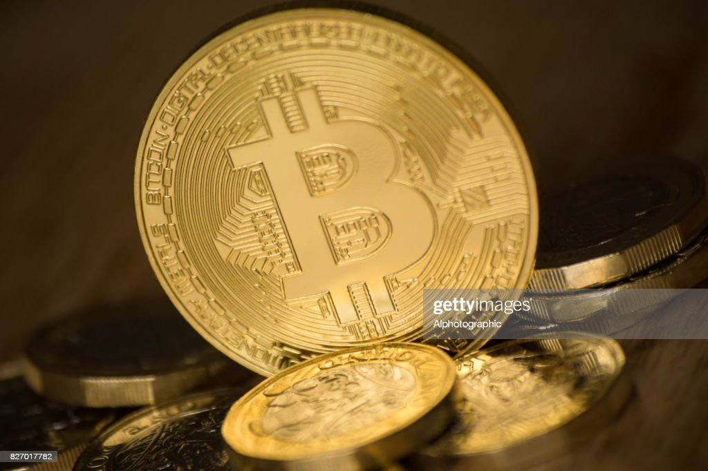 Bitcoin and one pound coins : Stock Photo