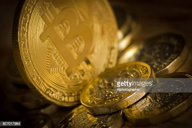 bitcoin and one pound coins - bitcoin stock photos and pictures