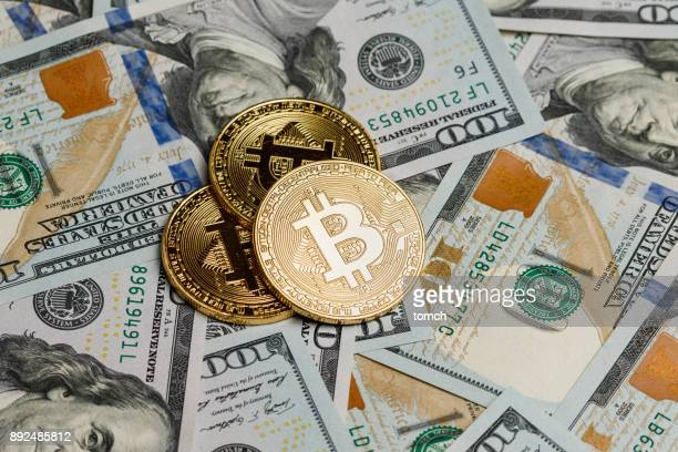 Bitcoin coins on dollars background
