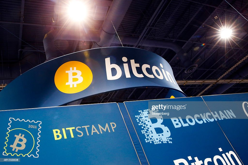 Bitcoin Corp. signage is displayed during the 2015 Consumer Electronics Show (CES) in Las Vegas, Nevada, U.S., on Thursday, Jan. 8, 2015. This year's CES will be packed with a wide array of gadgets such as drones, connected cars, a range of smart home technology designed to make everyday life more convenient and quantum dot televisions, which promise better color and lower electricity use in giant screens. Photographer: Patrick T. Fallon/Bloomberg via Getty Images