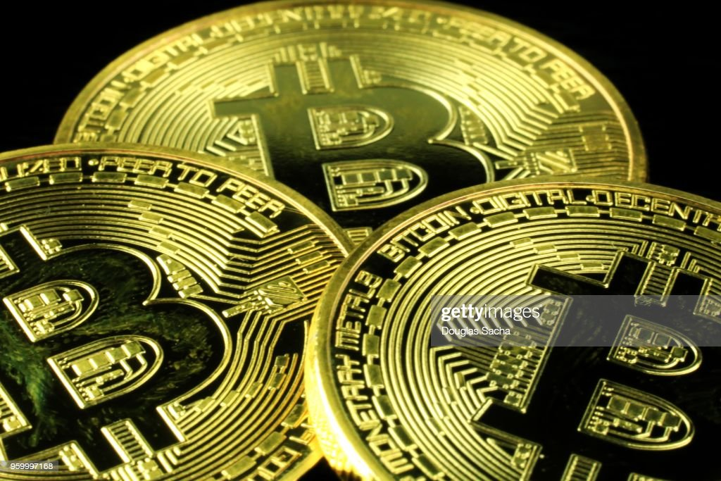 Bitcoin Cryptocurrency Coins on a black background : Stock-Foto