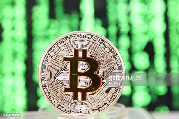 Bitcoin cryptocurrency symbolic coin is seen in front of computer screen in this photo illustration in Gdansk Poland on 1 November 2017 The price of...