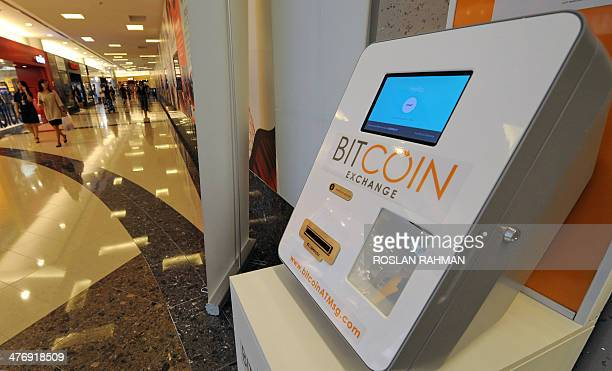 A Bitcoin dispensing machine is seen at a shopping mall in Singapore on March 6 2014 Singapore's police said March 6 they were investigating the...