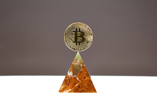 Bitcoin floating above an Onyx Stone Pyramid - gettyimageskorea