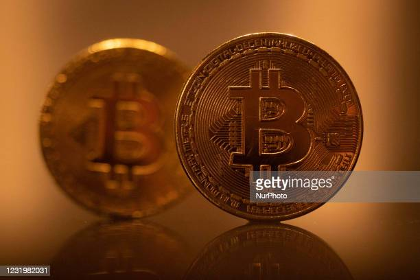 Bitcoin golden physical coin illustration on dark black background with reflection. Visual representations of the digital Cryptocurrency Bitcoin....