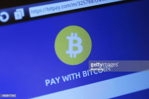 A bitcoin logo is displayed on the screen of the BMEX bitcoin exchange's Robocoinbranded automated teller machine at The Pink Cow restaurant and bar...