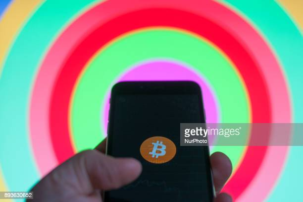 A bitcoin logo is seen on an iPhone in this photo illustration on December 15 2017
