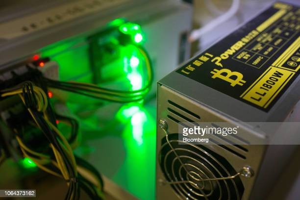 Bitcoin logo sits on a LL 1800W power unit supplying cryptocurrency mining machines at the SberBit mining 'hotel' in Moscow, Russia, on Saturday,...