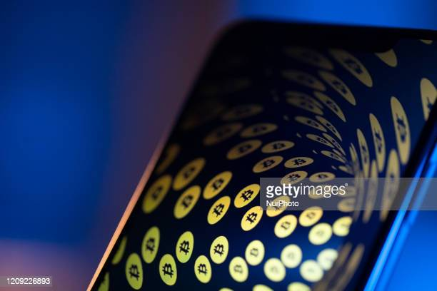 Bitcoin logos are seen on an iPhone 11 Pro Max in this illustration photo in Warsaw Poland on April 4 2020