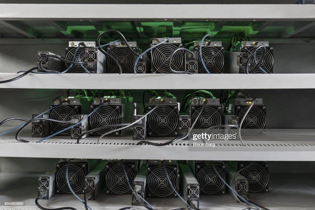 Bitcoin mining machines operate at a mining facility by Bitmain Technologies Ltd. in Ordos, Inner Mongolia, China, on Friday, Aug. 11, 2017. Bitmainis one of the leading producers of bitcoin-mining equipment and also runs Antpool, a processing pool that combines individual miners from China and other countries, in addition to operating one of the largest digital currency mines in the world. Photographer: Qilai Shen/Bloomberg via Getty Images