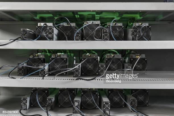 Bitcoin mining machines operate at a mining facility by Bitmain Technologies Ltd in Ordos Inner Mongolia China on Friday Aug 11 2017 Bitmainis one...