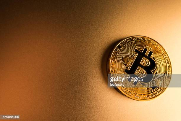 bitcoin on a golden surface