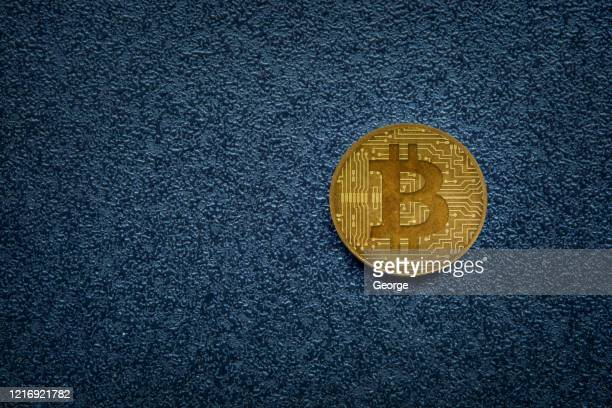 bitcoin on dark background - bitcoin stock pictures, royalty-free photos & images