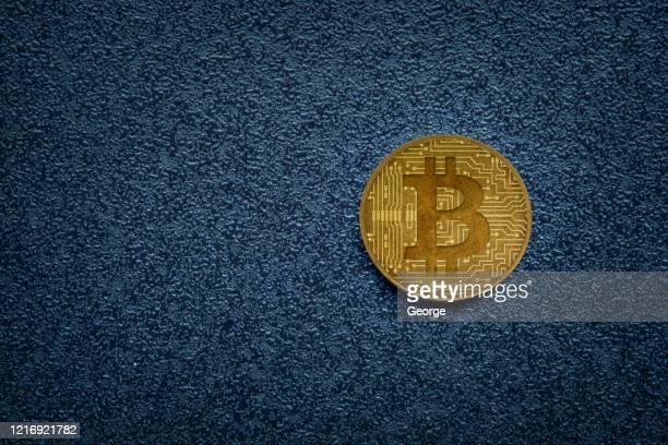 bitcoin on dark background - bitcoin stock-fotos und bilder