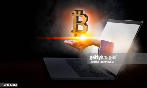 bitcoin or crypto currency concepts out of a computer mixed media - bitcoin stock pictures, royalty-free photos & images
