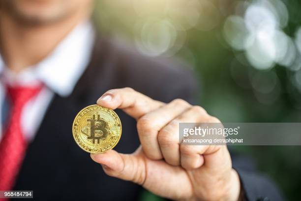 Bitcoin. Physical bit coin. Digital currency. Cryptocurrency. Golden coin with bitcoin symbol isolated on green background.Thailand,Date 5/07/2018