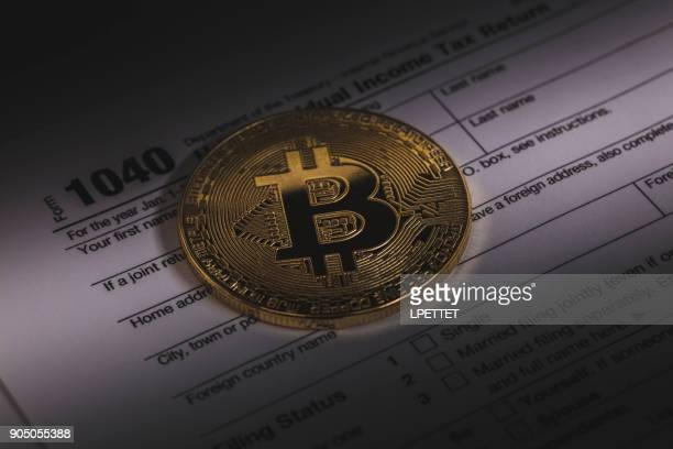 bitcoin - 1040 tax form stock photos and pictures