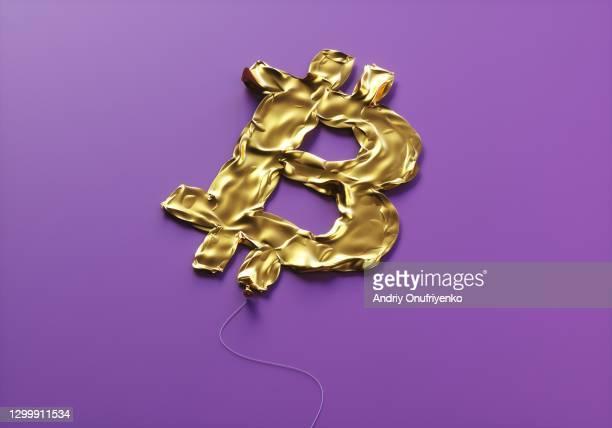 bitcoin sign balloon deflated - bitcoin stockfoto's en -beelden