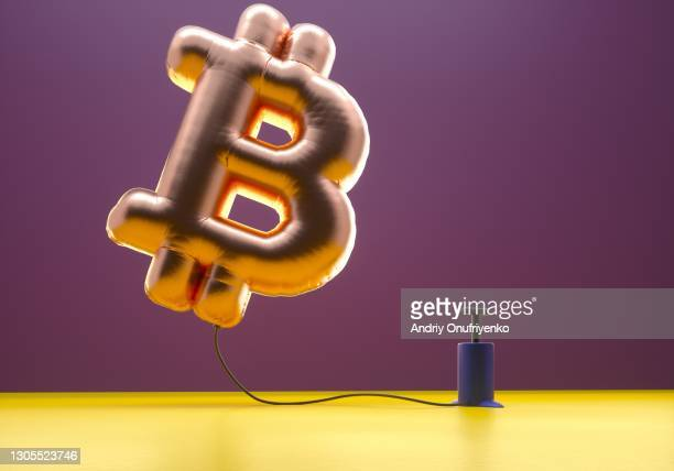 Bitcoin sign balloon inflating