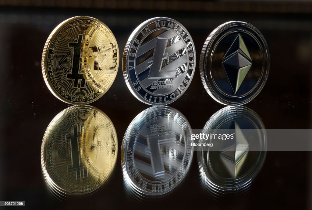 Crypto Currency Tokens As Billionaire Warren Buffett Said That Most Digital Coins Wont Hold Their Value : News Photo