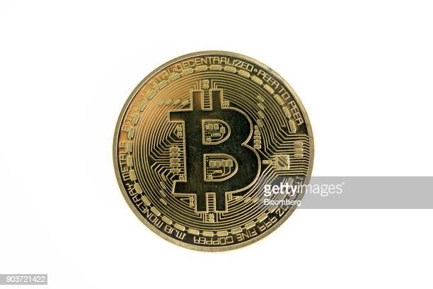 A bitcoin token sits in this arranged photograph in London UK on Tuesday Jan 9 2018 On Wednesday billionaireWarren Buffettsaid on CNBC that most...