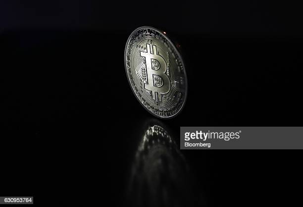 A bitcoin token stands in this arranged photograph in London UK on Wednesday Jan 4 2017 The electronic coin that trades and is regulated like oil and...