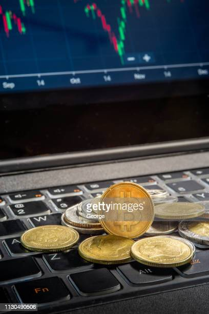 bitcoins and laptop - cryptocurrency stock pictures, royalty-free photos & images