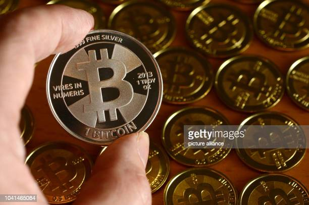 Bitcoins photographed at the oline coin dealer 'BitcoinCommodities' in Berlin, Germany, 28 November 2013. Bitcoin is an open source peer-to-peer...